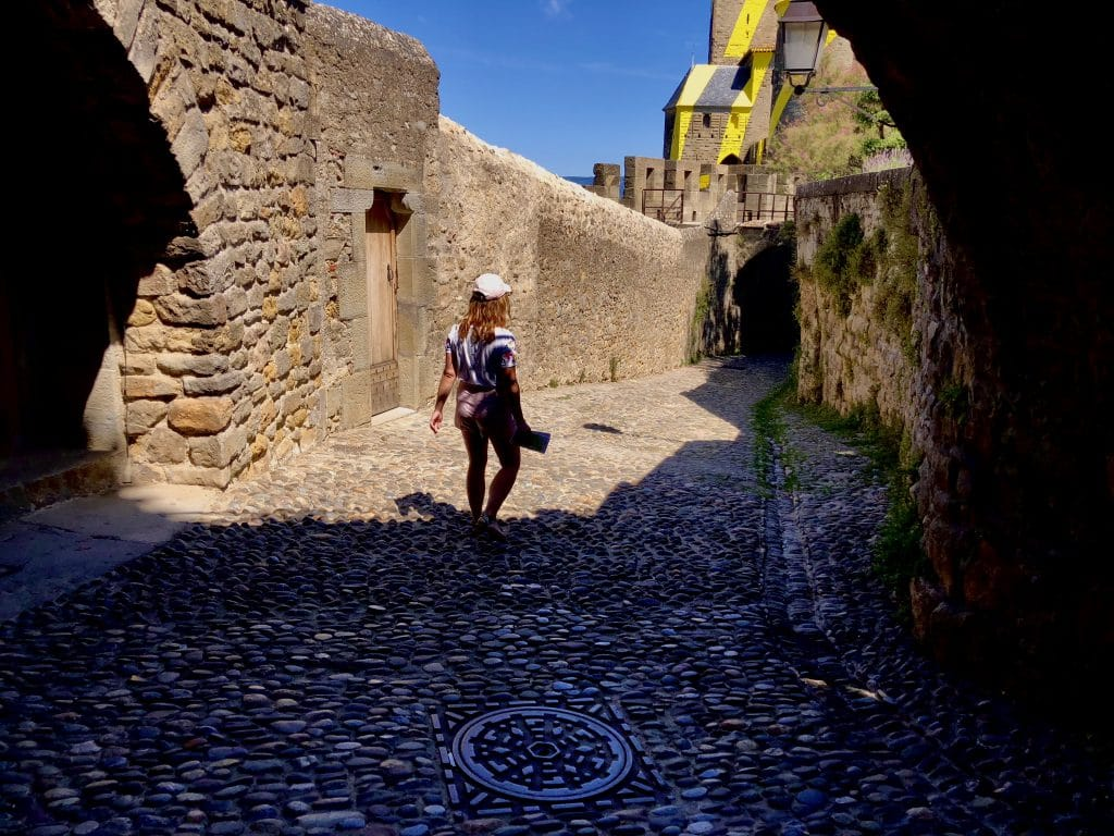Alexandra walking around in Carcassonne medieval city