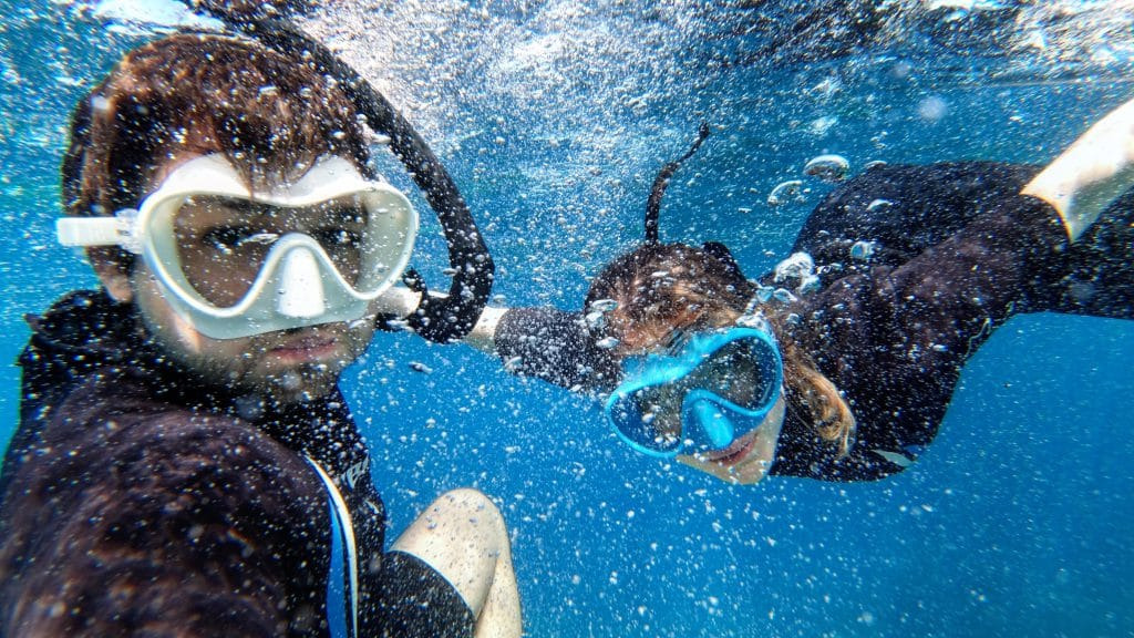 Francois and Alexandra snorkling in Porquerolles island, South of France.